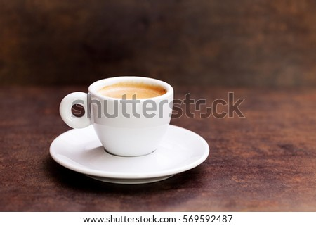White cup of espresso coffee on background  #569592487