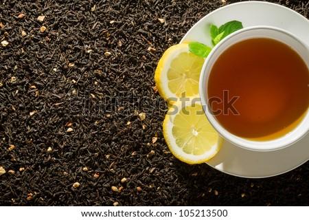 White cup of tea on dark background