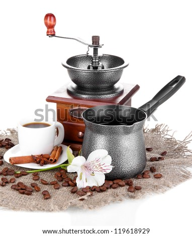 White cup of Turkish coffee with coffee mill and coffee pot isolated on white