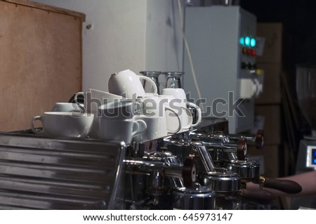 White Cup on the big coffee machine selling coffee. Selective focus. #645973147