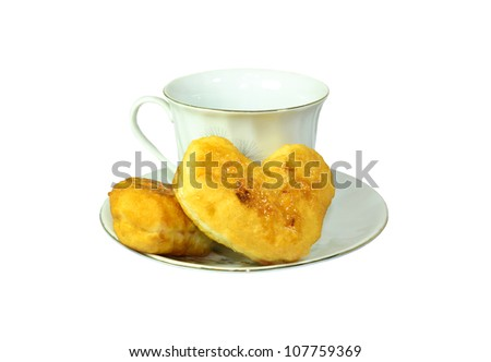 white cup with heart shape on saucer isolated on white