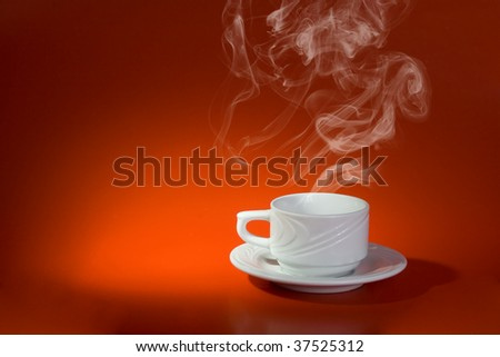 White cup with hot drink on red background