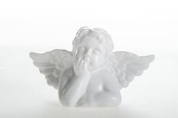 white cupid ceramic figure isolated on white background
