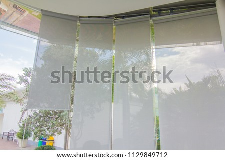 White curtain or blinds Roller sun protection and big Glass windows. #1129849712