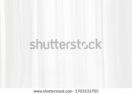 white curtain wavy with a pattern background. transparent curtain on window