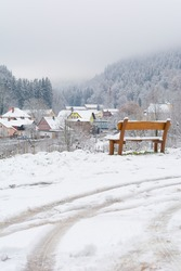 White darkness beautiful view from white wooden bench in Promenada in mountain village Horni Marsov in Giant Mountains