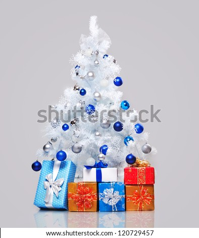 White decorated christmas tree isolated on neutral grey background