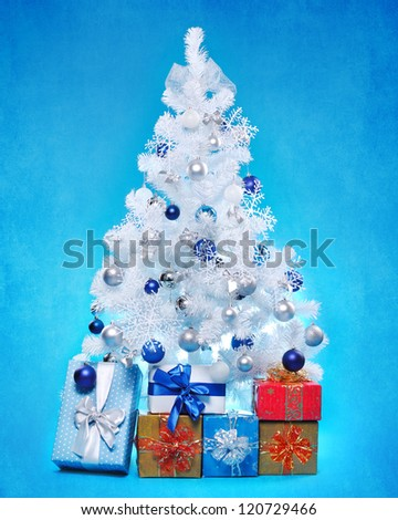White decorated christmas tree  on blue background