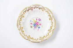 white decorative plate with floral pattern on white background