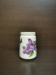 white decoupage vase with floral print, beautiful handmade DIY decoupage flower vase on wooden background