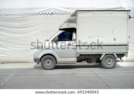White delivery truck with copy space parked on the road captured by side view