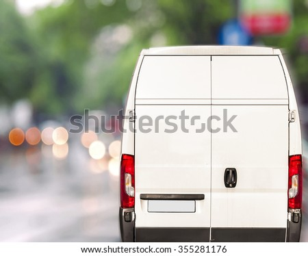 Shutterstock White delivery Van driving fast on city blurr bokeh street