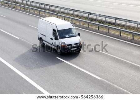 White Delivery Van On Highway #564256366