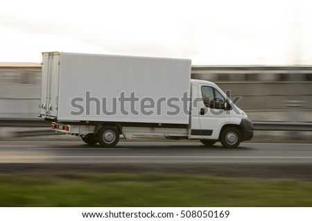 white delivery van on road in motion