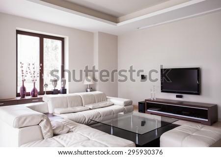 White designed living room in modern house