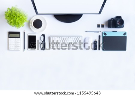 White desk office with laptop, smartphone and other work supplies with cup of coffee. Top view with copy space for input the text. Designer workspace on desk table essential elements on flat lay. #1155495643