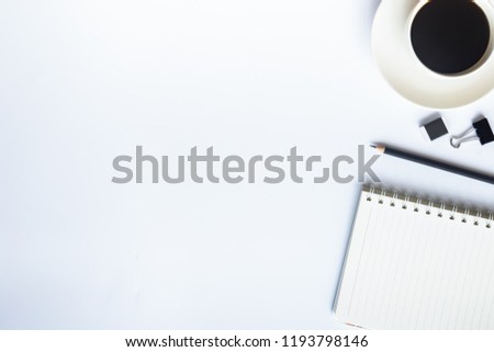 White desk office with laptop, smartphone and other work supplies with cup of coffee. Top view with copy space for input the text. Designer workspace on desk table essential elements on flat lay. #1193798146