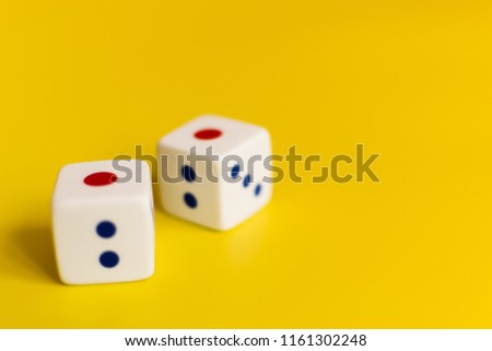white dice on a yellow background different values of numbers #1161302248