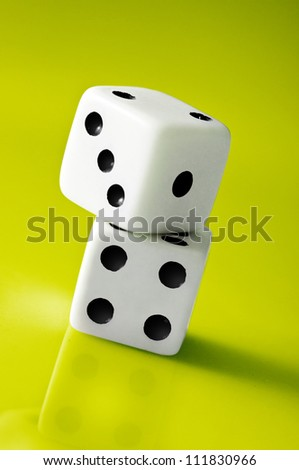 White Dice on Green Background
