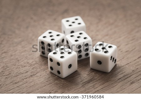 White dice on wooden background. All number five. Concept of luck, chance and leisure fun. #371960584