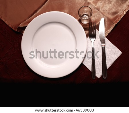 White dish with fork and knife