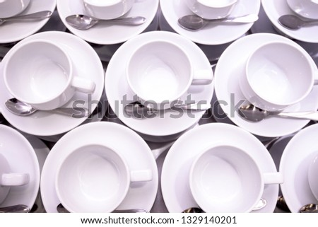 White dishware stacked on table #1329140201