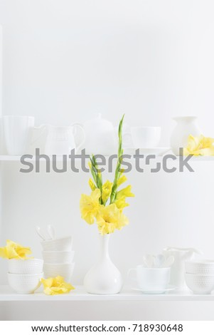 white dishware with flowers on wooden shelf #718930648