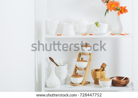 white dishware with flowers on wooden shelf #728447752