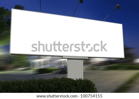 white display advertising with traffic at night - Shutterstock ID 100754155