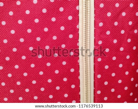 White dots over red Polka dot fabric, zipper background and texture  #1176539113