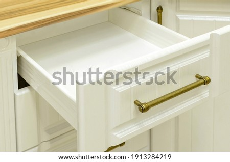 White drawer counter in kitchen.home furniture in neoclassicism style