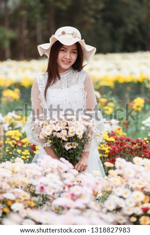 380a9d0e02 White dress pretty Asian girl wearing a flower crown holding a flowers  bouquet at the flower