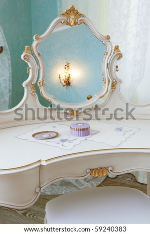white dressing table in a modern bedroom
