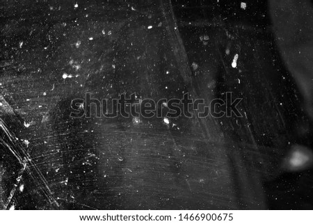 white dust and scratches on a black background. The texture of dirt on the glass. #1466900675