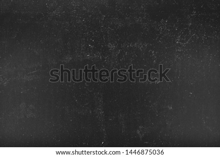 White dust and scratches over black surface. Distressed effect background. Empty space.