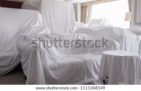 White dust cover cloth covering furnitures in a room #1111368149