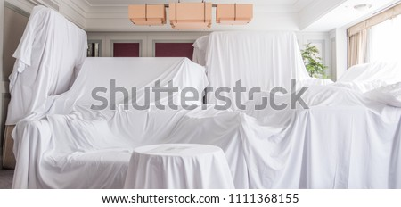 White dust cover cloth covering furnitures in a room #1111368155