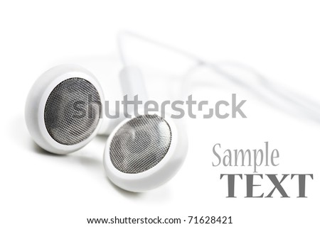White earphones on a white background with space for text