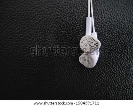 white earphones with black background