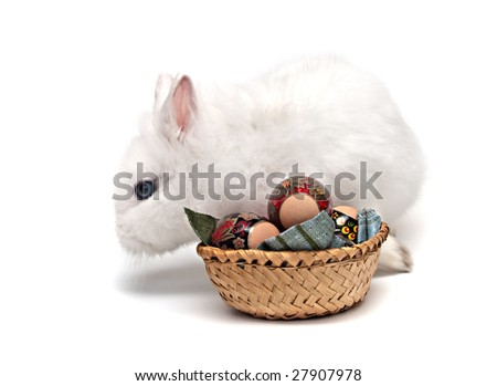 white Easter bunny with colored eggs and basket