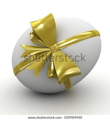 White easter egg with gold ribbon