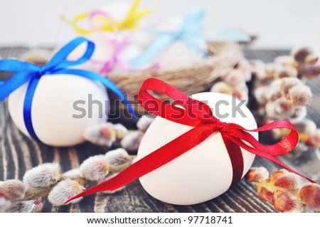 White easter eggs with color bow and willow