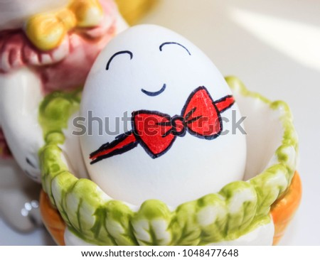 white egg with a cartoon painted face cartoon #1048477648