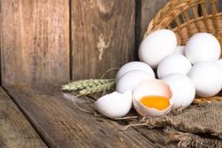 White eggs from the basket and broken egg