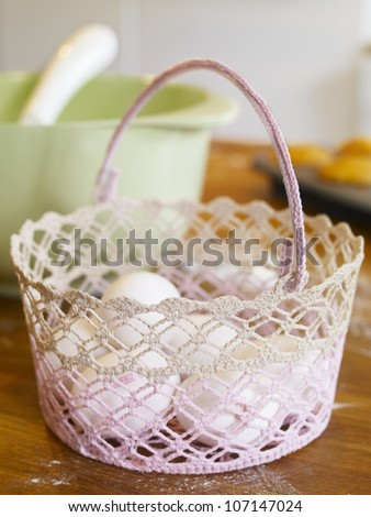 White eggs in knitted basket