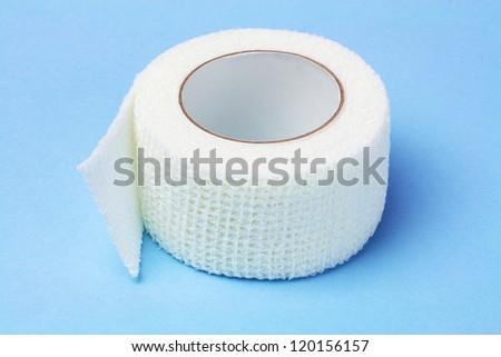 White Elastic Medical Bandage on Blue Background