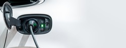 White electric car charging with copy space, Technology electric vehicle concept