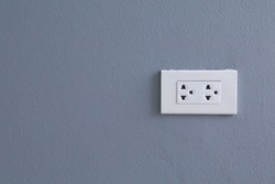 White electric plugs on blue wall background,White outlet interior, interior electric outlet in home,Socket electricity interior