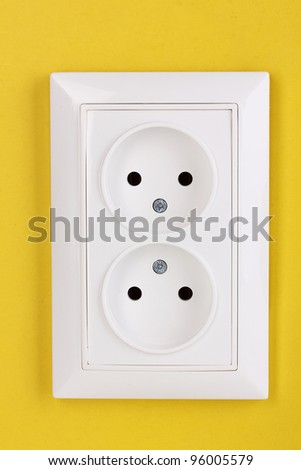 White electric socket on the wall