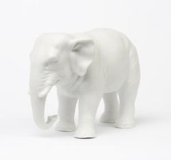 White elephant figure over white background.